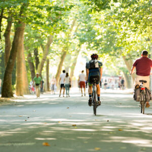 Man with a backpack on racebike in the Amsterdam Vondelpark - by pixable photostock
