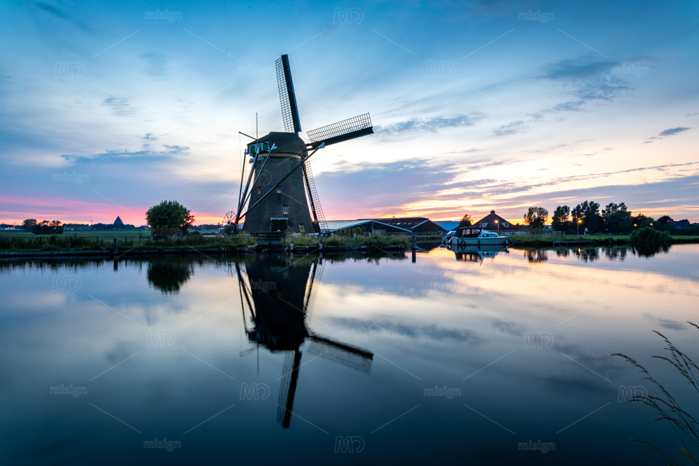 The historic Lisserpoel windmill build in 1676. Along the river the Ringvaart. On the Rooversbroekdijk in the Hellegatspolder in the Netherlands.