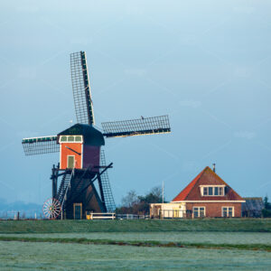 The back of the Red Mill in the grasslands of the South Holland villag of Oud Ade. Build in 1632