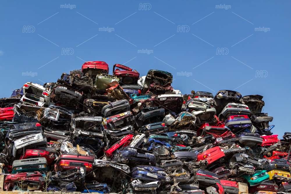 Stacked and crushed cars at a Amsterdam junkyard in the Netherlands.