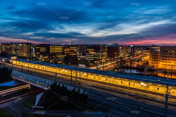 A evening sunset aerial view on the illuminated Metrostation Bullewijk in Amsterdam in the Netherlands.