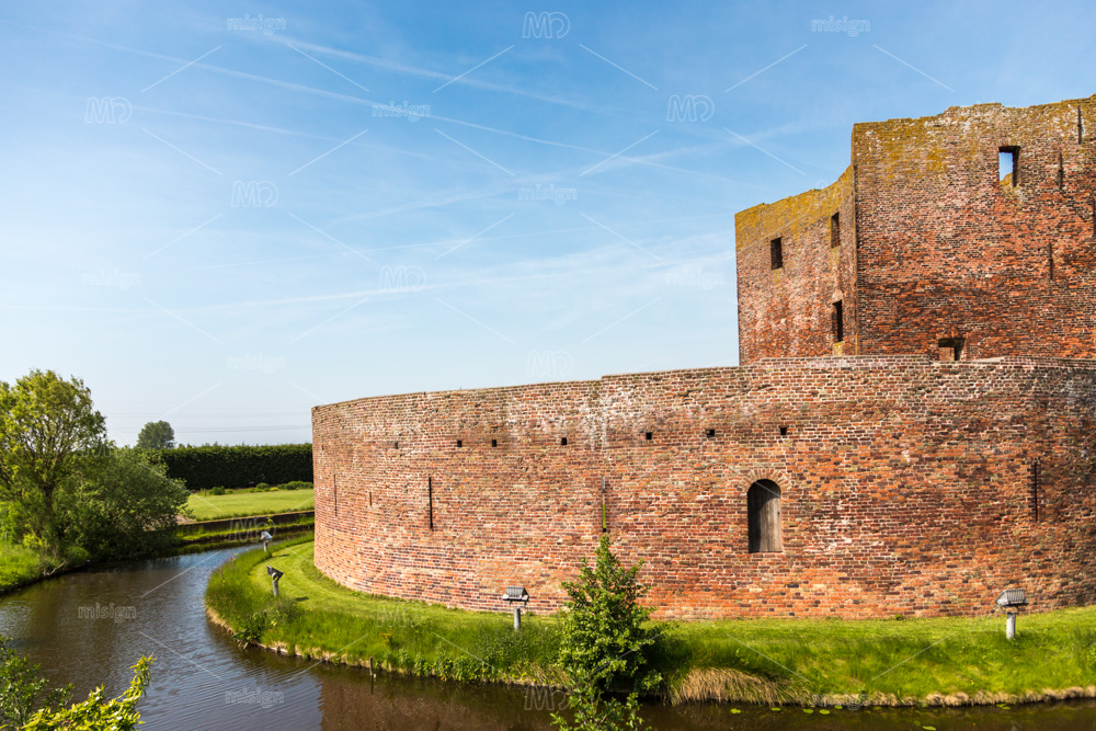 The ruin castle Teylingen with the round moat. In the South-Holland village of Sassenheim in the Netherlands.