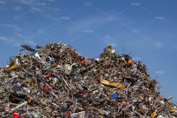 Mountains of collected scrap metal at a recycling junkyard in Amsterdam the Netherlands.