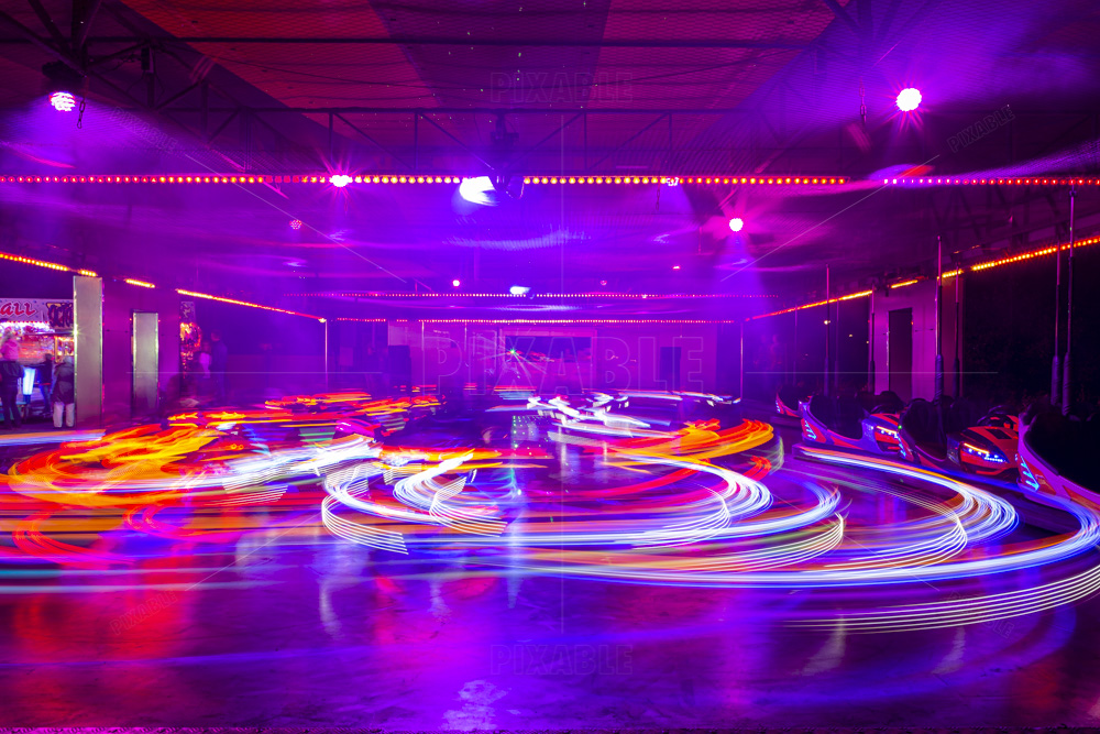 Blurry colourfull light lines from the fast moving bumper cars at the Sassenheim town fair in the Netherlands.