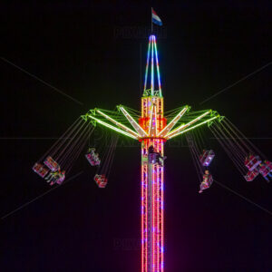 Blurry colourfull light lines from the fast moving whirligig at the Sassenheim town fair in the Netherlands.