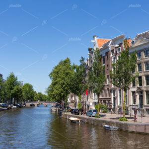 Historical canal houses on the Keizersgracht in the center of the Amsterdam with a blue sky in the Netherlands.