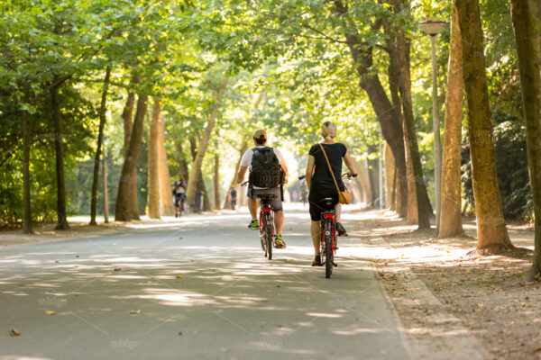 Man and woman biking in the Vondelpark in Amsterdam, Netherland.
