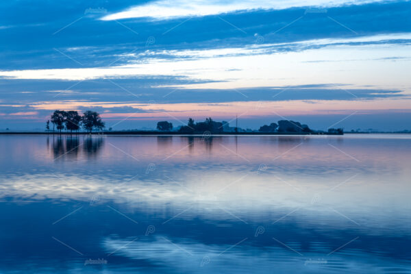 Summer sunrise over lake 't Joppe in the Kagerplassen in the South-Holland village of Warmond in the Netherlands.