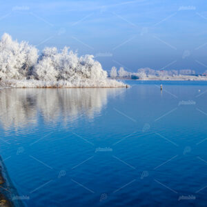 Winter landscape with frost on the trees around the Klinkenberger lake in the South-Holland village of Oegstgeest in the Netherlands.