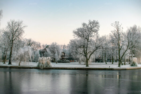 Frozen garden on the river the Leede in the South-Holland village of Warmond in the Netherlands