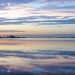 Sunrise over lake 't Joppe and the Kagerplassen in the South-Holland village of Warmond in the Netherlands.