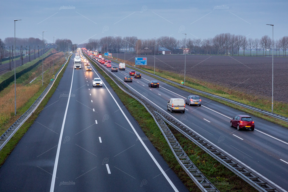 Cars driving in the evening on the A44 highway to the village of Sassenheim, Abbenes and Kaag in the Netherlands.