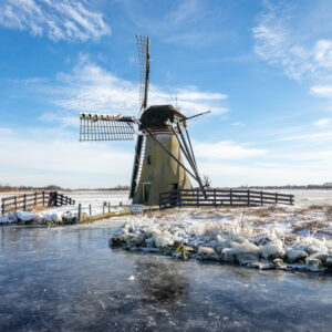 "Historic windmill ""de Kok"" on the frozen banks of the kogjespolder in Warmond."
