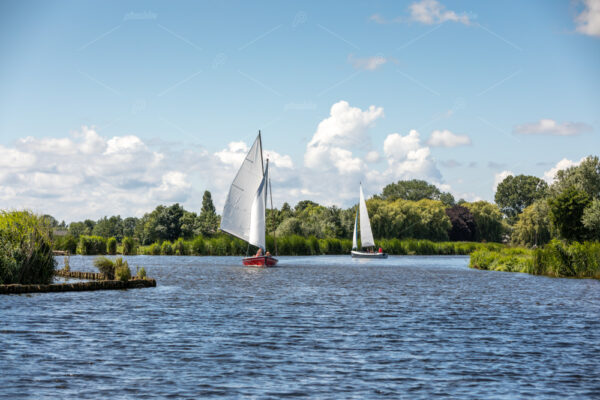 Sailboats on the Kagerplassen (Boerenbuurt) with people sailing in Rijpwetering.