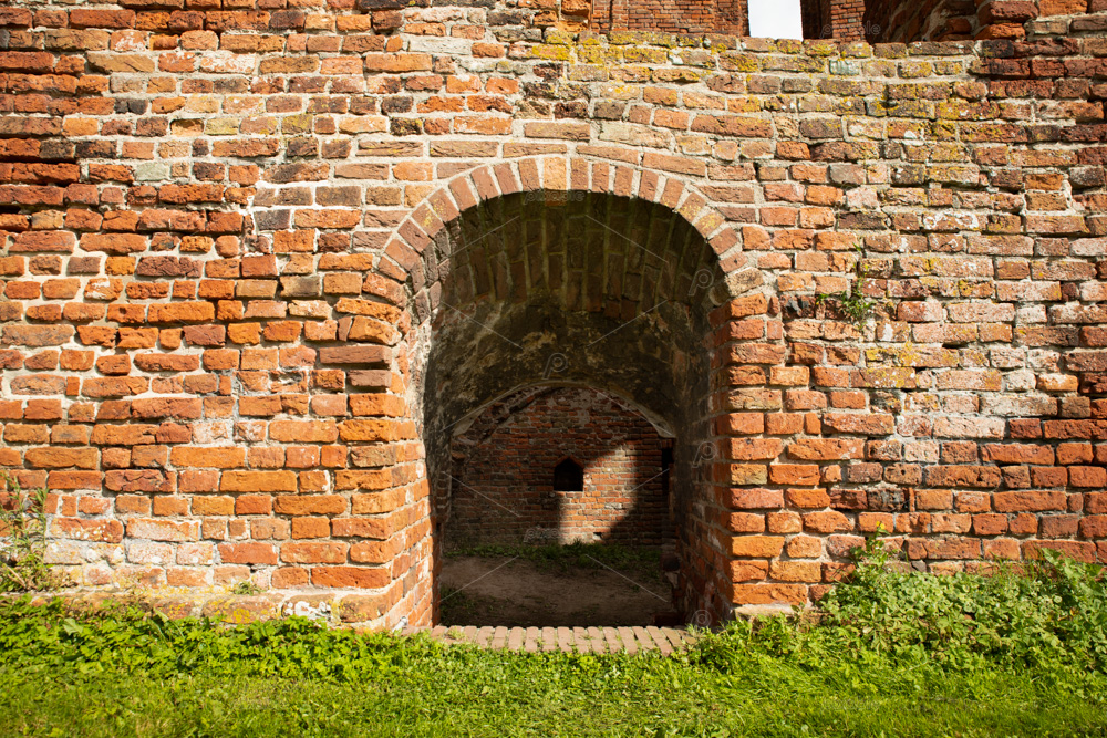 A kind of doorway downwards as seen from the outdoor area (the courtyard) of the ruin castle Teylingen in the south-holland village of Sassenheim in the Netherlands.